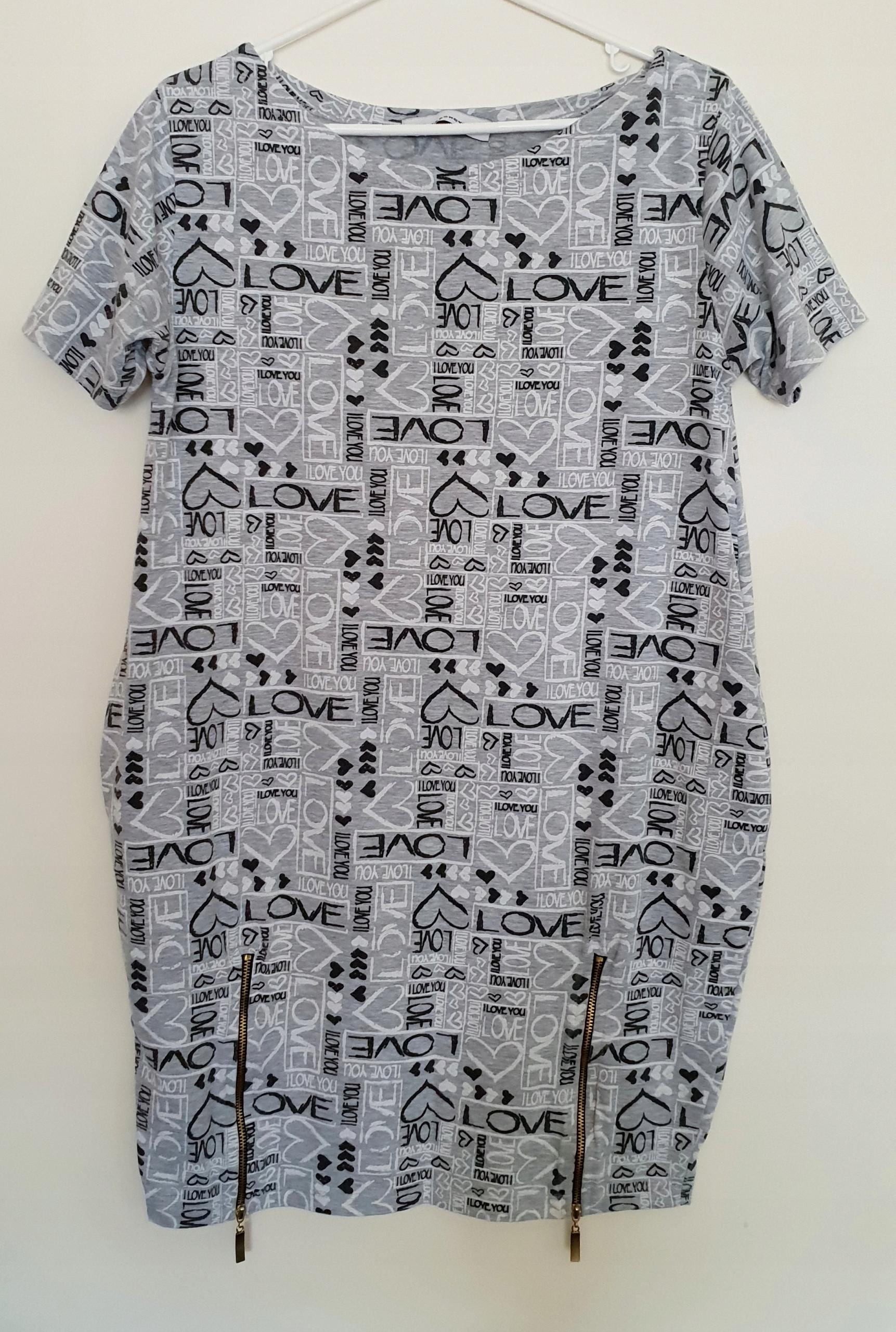 619956d3cf Dzianinowa sukienka z nadrukiem rozm M - 7562239771 - oficjalne ...